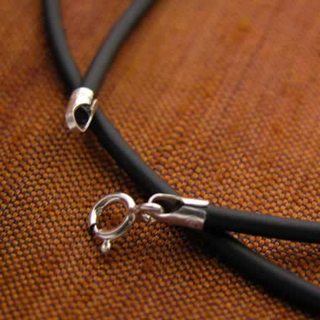 Rubber necklace with silver findings.
